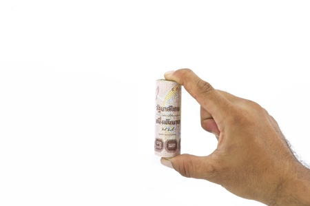 roll of one thousand baht thai banknote in hand on white background photo