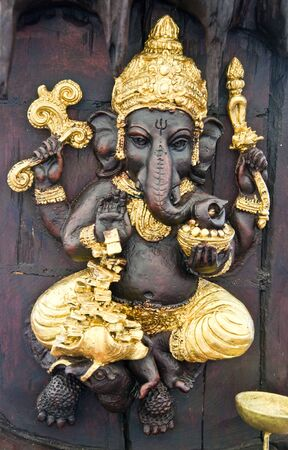 Lord Ganesha is carving by hand made on wood photo
