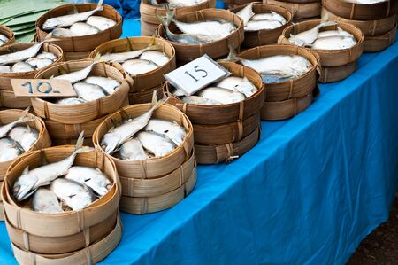 Mackerel fish in bamboo baskets on sale at market, Thailand  photo