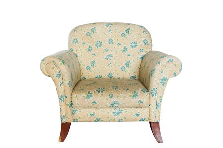 Detail and texture of  yellow Floral chintz chair on a white background.