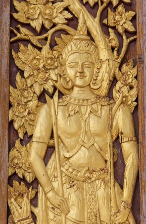 Thai style golden Deva carving with handcraft on wood Stock Photo