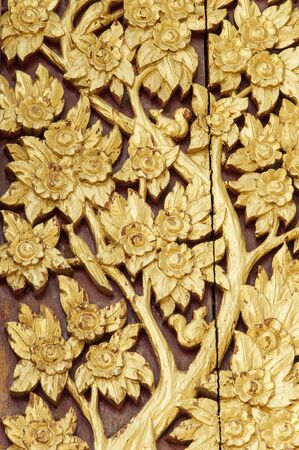 Thai style golden tree carving  handcraft with painted gold color on  wood Stock Photo