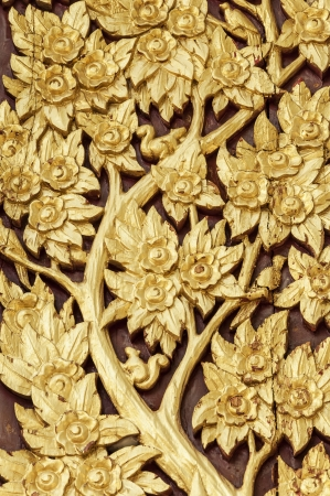 Thai style golden tree carving  handcraft with painted gold color on  wood photo