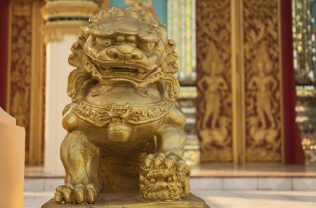 Gloden lion statue in the thai tample Stock Photo
