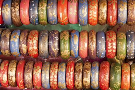 Colorful Bangles in a row on sale in the market photo