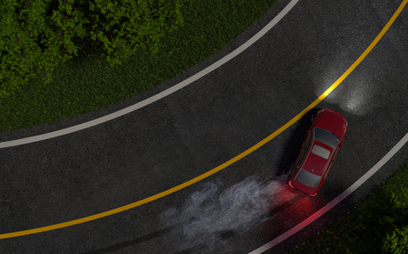 enters: red car enters the turn with skid. night