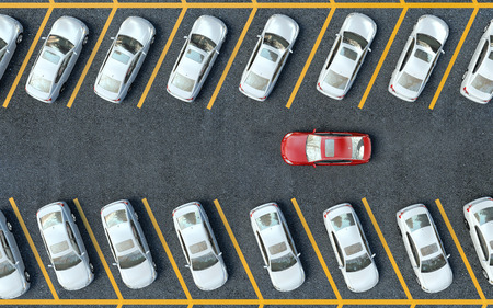 a lot: search for a parking space. Many cars parked Stock Photo