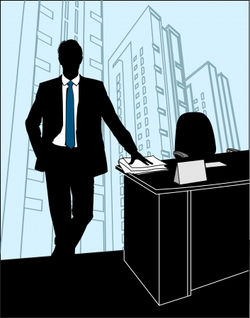 executive chair: man stands in the office near to the table on a background of skyscrapers