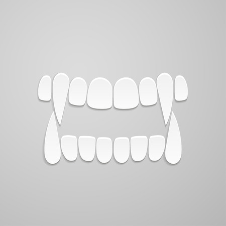 indentation: jaw with canines on grey background