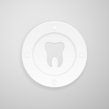 indentation: plate with a dent in the shape of a tooth on gray background
