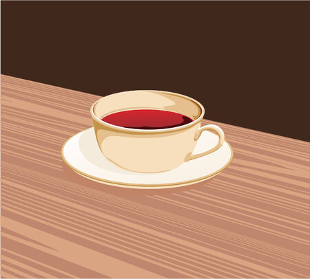 glas: cup of tea standing on a saucer on the table