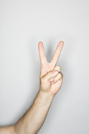 ring flash: isolated hand with victory sign,  photographed with ring flash