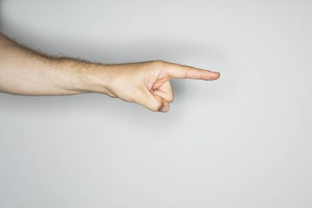finger on trigger: isolated hand gesture, photographed with ring flash