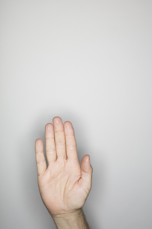ring flash: isolated hand gesture, photographed with ring flash