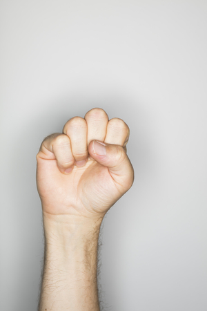 resistence: isolated hand gesture, photographed with ring flash