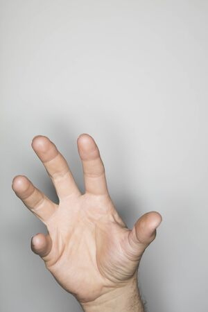 one item: isolated hand gesture, photographed with ring flash