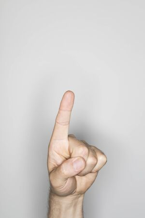 finger on trigger: isolated male hand, photographed in the studio