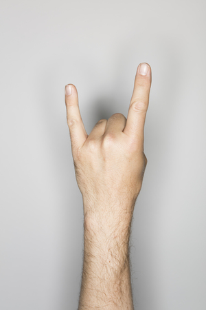 one item: isolated male hand, photographed in the studio