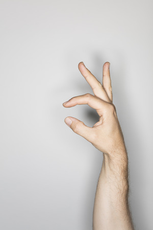 isolated male hand, photographed in the studio