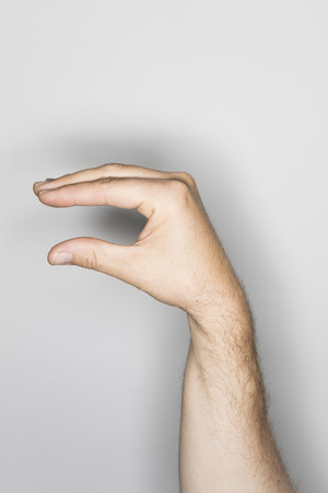 no body language: isolated male hand, photographed in the studio