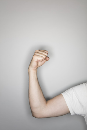 resistence: isolated male hand, photographed in the studio