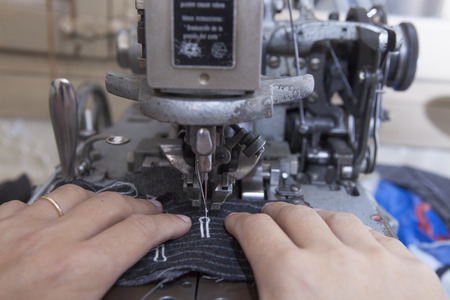 tailored: Production process of suit tailoring. Sewing of parts of a tailored jacket Stock Photo