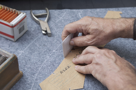 tailored: 25 September 2012 at a tailor in Barcelona, Spain. Production process of suit tailoring. drawing the outline of parts of a tailored jacket