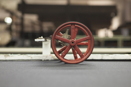 thread count: fabric at quality control. with a counting machine measuring the length of a textile piece roll. production of fine woolen fabrics for suits