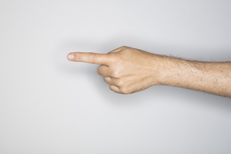 finger on trigger: human hand isolated in the studio