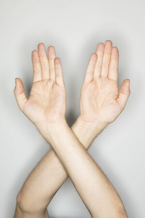 defend: two isolated caucasian hands in a gesture: defend