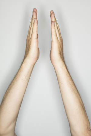 two isolated caucasian hands in a gesture: clapping over head