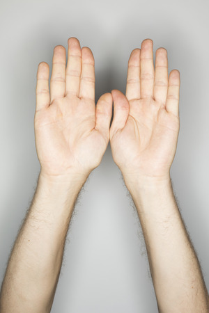 pelota de voley: two isolated caucasian hands in a gesture: defending like in volley ball