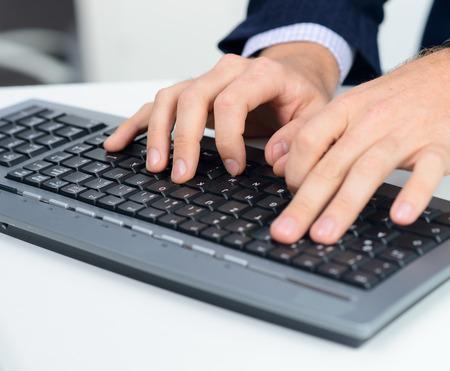 Hands and keyboard Standard-Bild