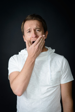 halitosis: man is tired