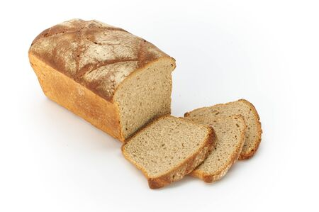 Traditional rural wheat bread, sliced on a white background