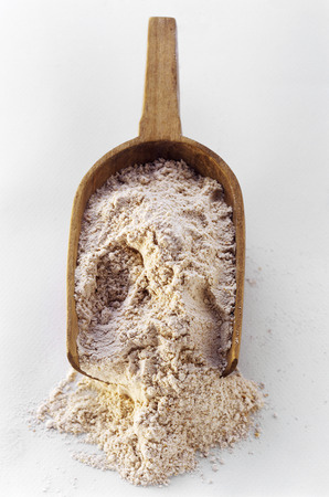wooden scoop: A Wooden Scoop Filled with Flour