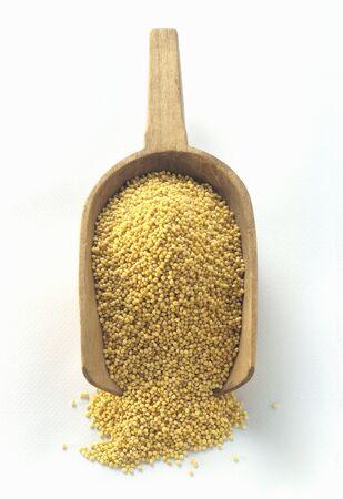 wooden scoop: Millet in a Wooden Scoop LANG_EVOIMAGES