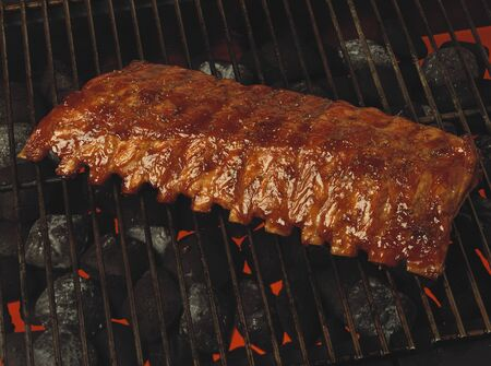 broiling: Marinated spare-ribs on barbecue