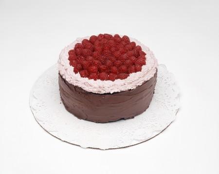 doiley: Chocolate cake with raspberries on doily