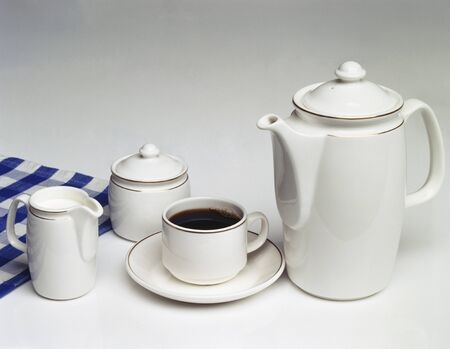 coffeepots: A cup of coffee. coffee pot. sugar bowl and cream jug LANG_EVOIMAGES