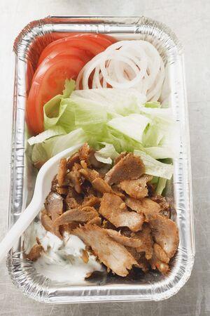 donner: Döner kebab with vegetables in aluminium dish