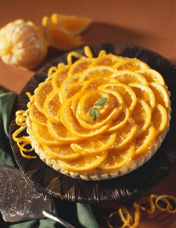 orange tart: Whole Orange Tart with Mint Garnish LANG_EVOIMAGES