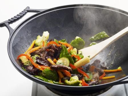 hobs: Stir-fried vegetables with beef being prepared