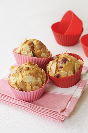 vaccinium macrocarpon: Cranberry muffins with slivered almonds