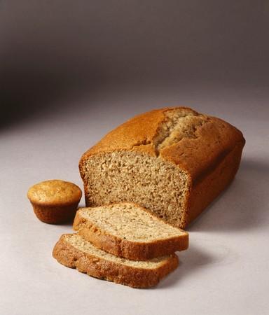 banana bread: Partially Sliced Load of Banana Bread; Banana Muffin LANG_EVOIMAGES