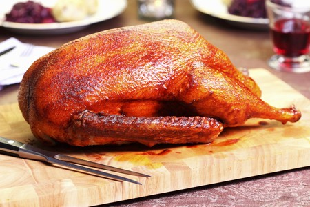 ovenbaked: Roast goose on a chopping board