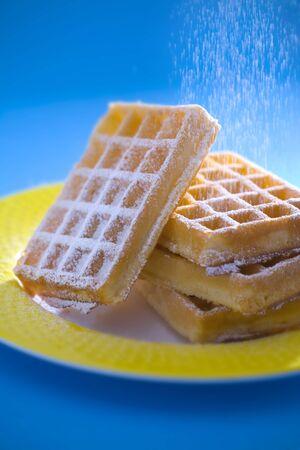 sprinkling: Sprinkling waffles with icing sugar