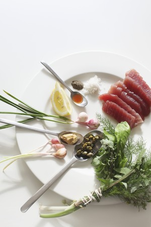 tunafish: Raw tuna, a bunch of herbs, capers and spring onions