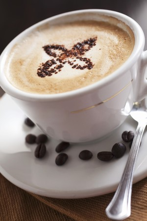 hot coffees: Cappuccino and coffee beans