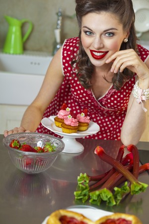 rheum: A retro-style girl with strawberry muffins, strawberries and rhubarb LANG_EVOIMAGES